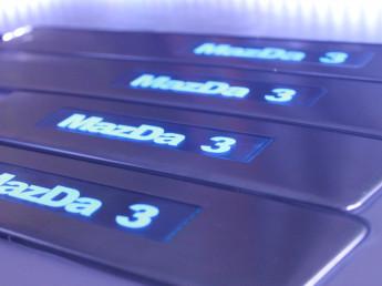 Накладки на пороги из стали с диодной подсветкой Mazda 3.