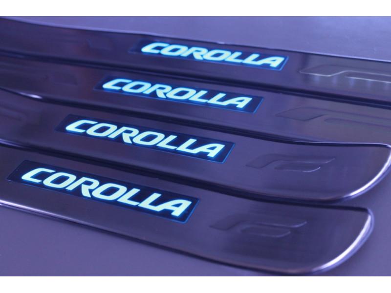 Накладки на пороги из стали с диодной подсветкой Toyota Corolla.